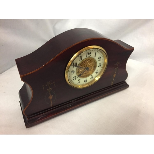 35 - AN INLAID MAHOGANY MANTLE CLOCK WITH GILDED CENTRE FACE AND ENAMEL DIAL