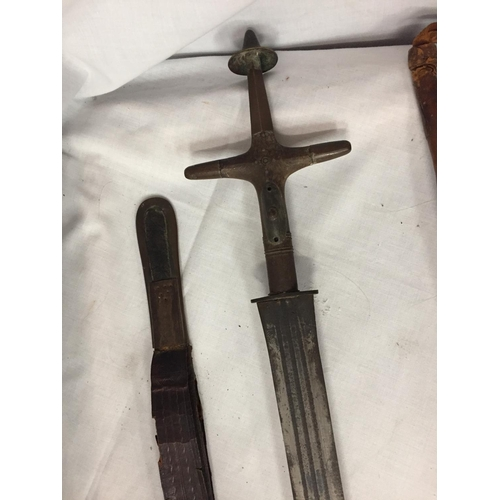 37 - A SWORD IN A LEATHER SHEATH  AND A VINTAGE LEATHER HORSE HAIR RIDING CROP