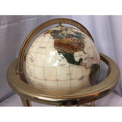 4 - A GEM STONE AND PEARLISED GLOBE ON BRASS STAND 32CM HIGH