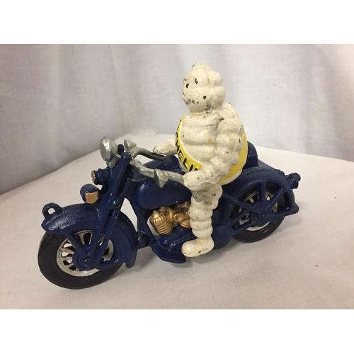 54 - A CAST MICHELIN MAN ON A MOTOR BIKE