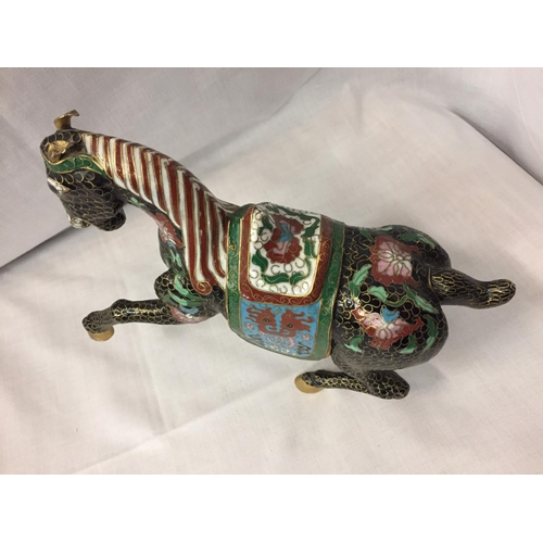 9 - A CHINESE BRONZE CLOISONNE ENAMEL AND GILT HORSE