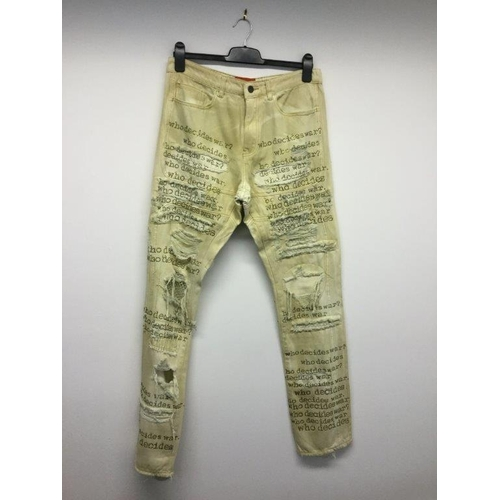 31 - WHO DECIDES WAR - a pair of ladies cream jeans, size 32...