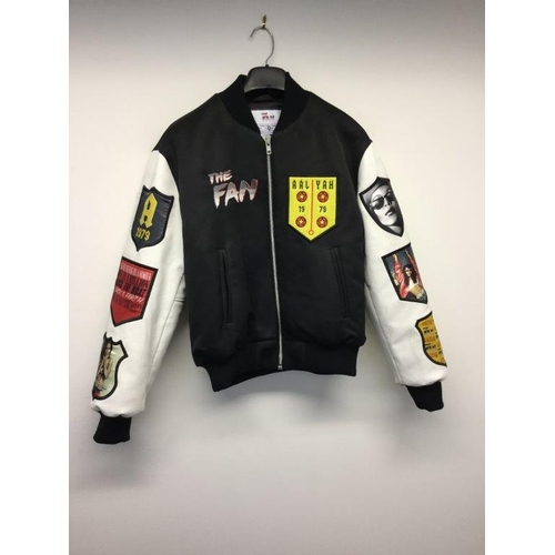 33 - THE FAN - a ladies black jacket with white sleeves, size small...