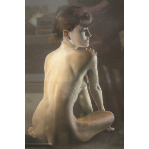 27 - A FRAMED AND GLAZED PASTEL PICTURE OF A SEATED FEMALE NUDE INITIALED RJ...