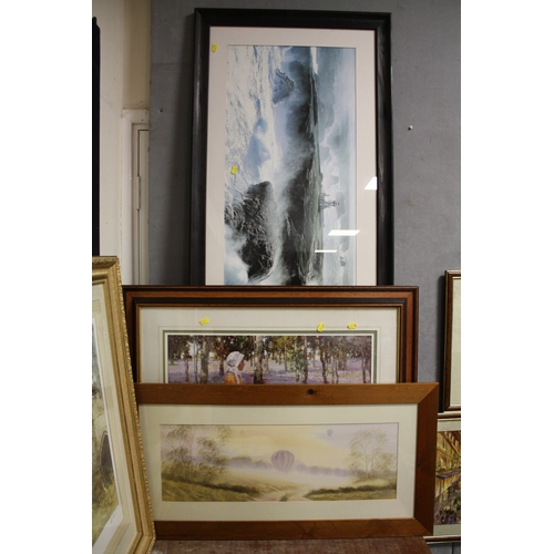 38 - TWO LARGE FRAMED AND GLAZED PRINTS TOGETHER WITH A WATERCOLOUR OF HOT AIR BALLOONS IN A COUNTRY LAND...