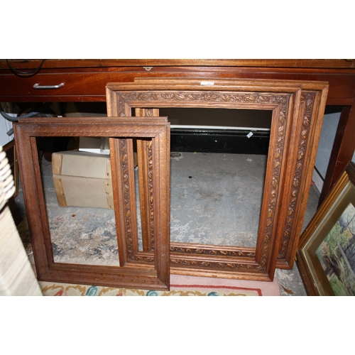 43 - A PAIR OF CARVED OAK PICTURE FRAMES TOGETHER WITH A PAIR OF SMALL OAK PICTURE FRAMES...