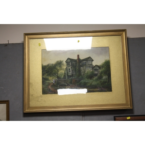 47 - A LARGE GILT FRAMED AND GLAZED WATERCOLOUR OF A TUDOR COUNTRY HOUSE BY A RIVER SIGNED JOHN THORLEY L...