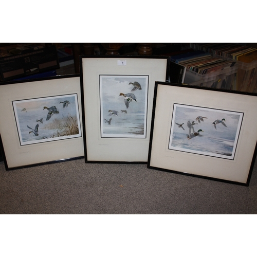 5 - THREE FRAMED AND GLAZED SIGNED JOHN CYRILL HARRISON PRINTS WITH BLIND STAMPS DEPICTING DUCKS FLIGHT...