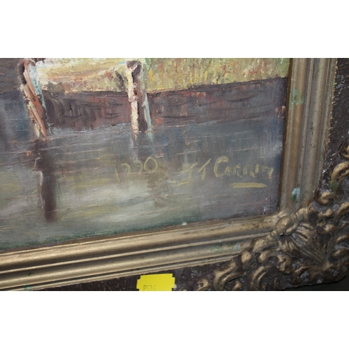 55 - A GILT FRAMED OIL ON CANVAS OF A WINDMILL BY A RIVER SIGNED JT CARTER...