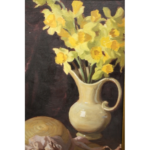 57 - A GILT FRAMED OIL ON BOARD OF A STILL LIFE STUDY OF DAFFODILS IN A JUG, MARKED LEO FISON BATES VERSO...
