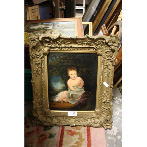 60 - AN ANTIQUE GILT FRAMED OIL ON BOARD OF A YOUNG BOY WITH HIS HAND IN A GOLDFISH BOWL...