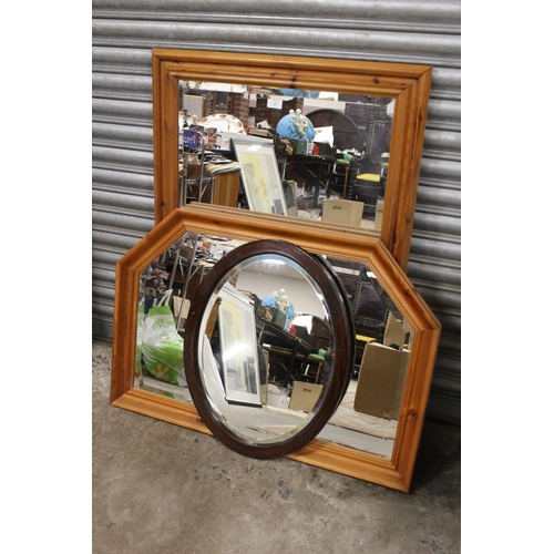 17 - TWO PINE FRAMED OVERMANTEL MIRRORS TOGETHER WITH AN OVAL SHAPED EXAMPLE (3) LARGEST OVERALL -75CM X ...