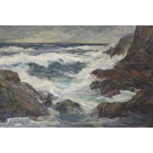 43 - (XX). A stormy rocky coastal scene with heavy surf breaking on rocks. Indistinctly signed lower righ...