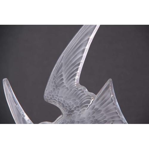 24 - R. LALIQUE AN UNUSUAL HIRRONDELLES mounted on an original bronze branch work base - impressed mark R...