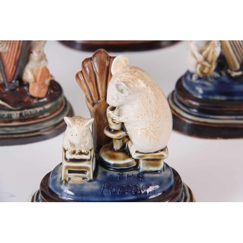 39 - A LATE 19TH CENTURY COLLECTION OF SIX DOULTON LAMBETH MOUSE MENU HOLDERS BY GEORGE TINWORTH comprisi...