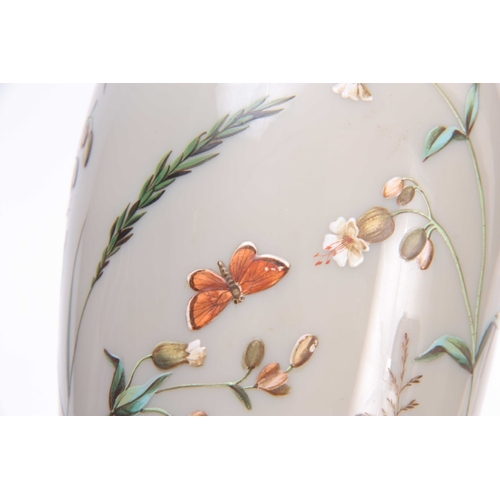 13 - AN EARLY 20TH CENTURY FRENCH OPAQUE GLASS VASE decorated with enamel butterflies amongst flowers 23c...