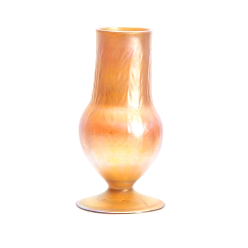 16 - A TIFFANY FAVRILE IRIDESCENT FOOTED BALUSTER VASE with moulded panelled body 20.5cm high - engraved ...
