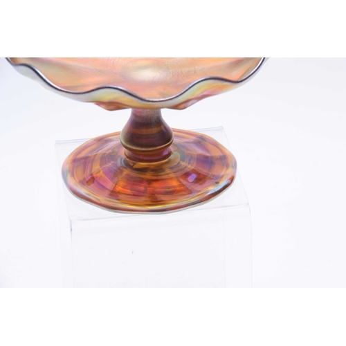 17 - A TIFFANY, FAVRILE IRIDESCENT GLASS FOOTED COMPOTE with baluster stem, panelled foot and bowl with s...