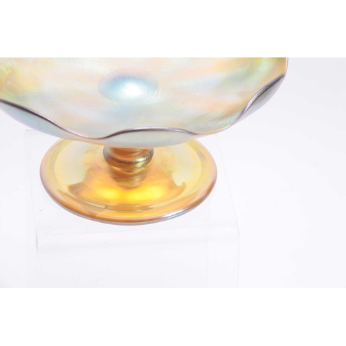 18 - A TIFFANY, FAVRILE IRIDESCENT GLASS FOOTED COMPOTE with baluster stem, plain folded foot and moulded...