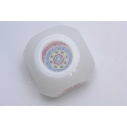 7 - A 19TH CENTURY MILLEFIORI WHITE OPAQUE CASED GLASS PAPERWEIGHT with clear oval side panels and circu...