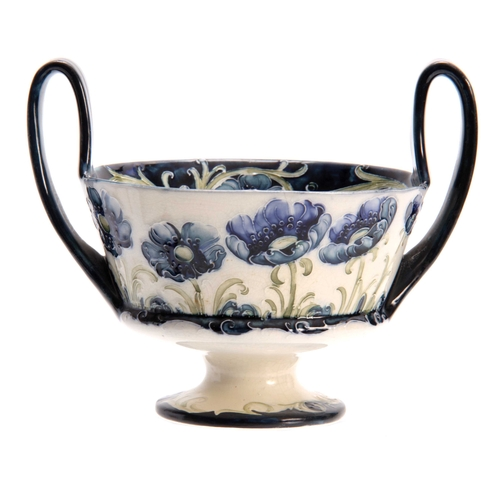 35 - A MACINTYRE, BURSLEM WILLIAM MOORCROFT RAISED TWO-HANDLE FOOTED BOWL with tube lined blue Poppy deco...