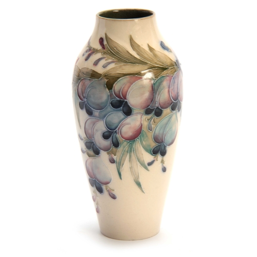 42 - A MACINTYRE BURSLEM SLENDER TAPERING SHOULDERED VASE DESIGNED BY WILLIAM MOORCROFT tube lined and de...