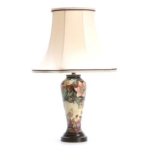 44 - A MODERN MOORCROFT TABLE LAMP with colourful tube lined flower decoration 47cn high to top of the sh...