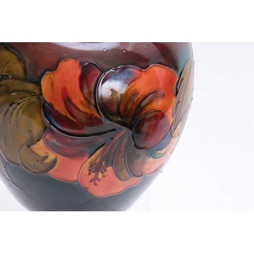 45 - A WALTER MOORCROFT LARGE BULBOUS GINGER JAR AND COVER with colourful tube lined decoration of leafin...