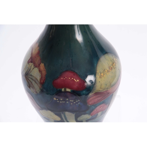 52 - A MOORCROFT CLAREMONT BALUSTER VASE the body decorated with a continuous band of unusual toadstools ...