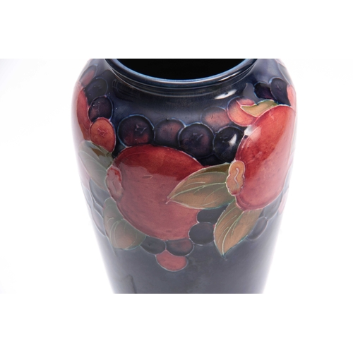 54 - AN EARLY 20th CENTURY WILLIAM MOORCROFT VASE with pomegranate design, signed and impressed marks to ...