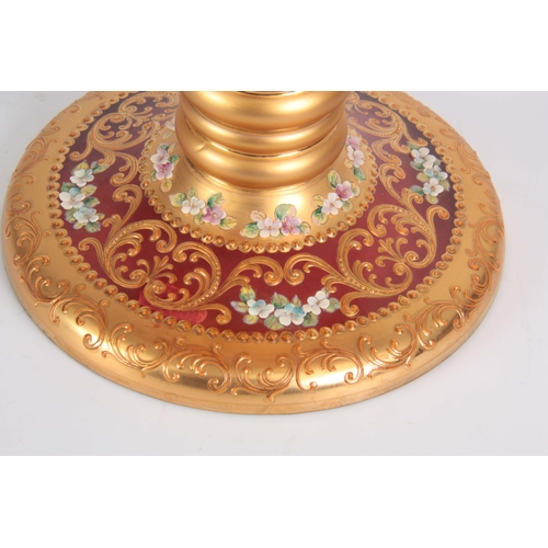 19 - AN IMPRESSIVE VENITIAN GIANT-SIZE CRANBERRY GLASS GOBLET with richly gilt ringed tapering stem and f...