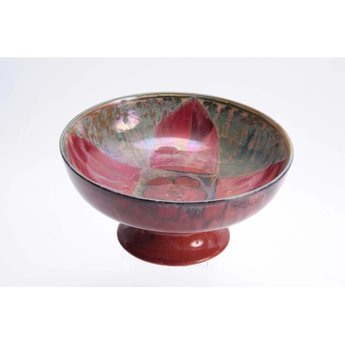 52 - A PILKINGTON'S ROYAL LANCASTRIAN FOOTED BOWL BY GLADYS ROGERS having a red and green glaze with a ye...