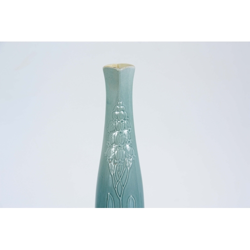 55 - AN EARLY 20TH CENTURY VILLEROY AND BOCH ART NOUVEAU VASE with tube lined decoration having quatrefoi...