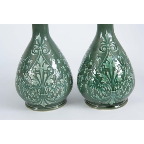 59 - A PAIR OF 19TH CENTURY DOULTON LAMBETH PATE SUR PATE DECORATED VASES decorated with foliage bearing ...
