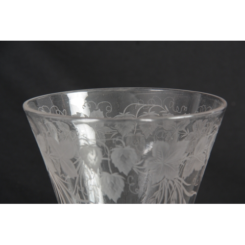 6 - AN 18TH CENTURY STYLE GLASS GOBLET Circa 1880 with a flat foot, multi-spiral air twist stem and flar...