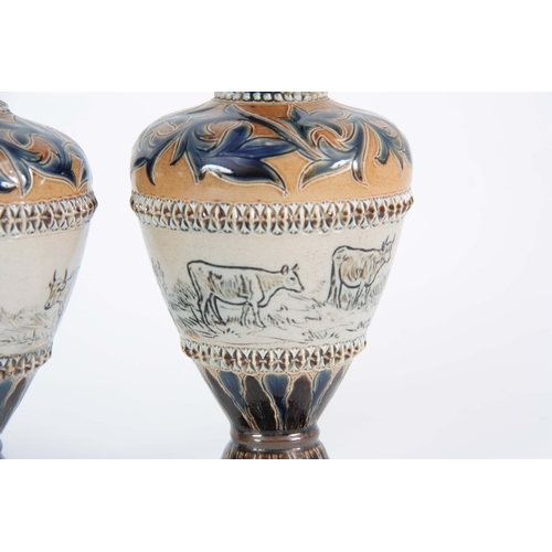 69 - A PAIR OF 19TH CENTURY HANNAH BARLOW DOULTON LAMBETH VASES decorated with cattle being of ovoid shap...