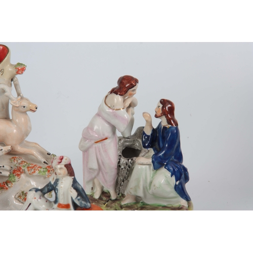 100 - A SELECTION OF FIVE 19TH CENTURY STAFFORDSHIRE FIGURES comprising of a hound hunting staff spill vas...