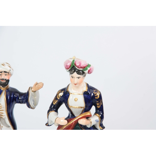103 - A SELECTION OF THREE 19TH CENTURY STAFFORDSHIRE PORCELAIN FIGURES comprising of a Turkish lady playi...