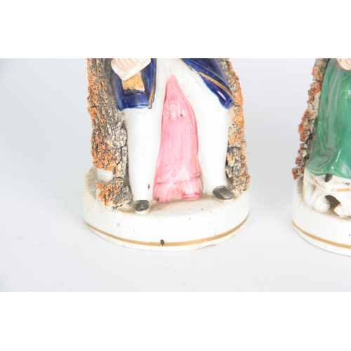 105 - A PAIR OF 19TH CENTURY STAFFORDSHIRE FIGURES depicting Victoria and Albert 17cm high....