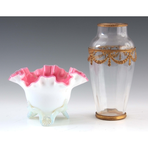 12 - A 19TH CENTURY PINK LINED OPALINE GLASS VASE standing on a shell moulded tripod base, 11cm high, 17c...