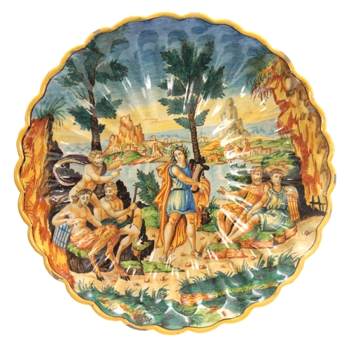 131 - A 17TH CENTURY ITALIAN MAJOLICA POLYCHROME FLUTED FOOTED SHALLOW DISH depicted an allegorical scene ...