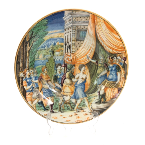 133 - A 17TH CENTURY ITALIAN MAJOLICA POLYCHROME SHALLOW DISH with all over painted decoration of young wa...