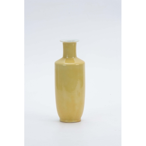 140 - AN IMPERIAL YELLOW-GLAZED TAPERING VASE WITH Kangxi six-character mark in underglaze blue 21cm high....