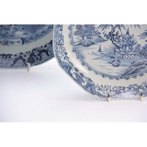 153 - AN 18TH CENTURY CHINESE BLUE AND WHITE SHALLOW DISH with fenced garden scene and butterfly centre en...