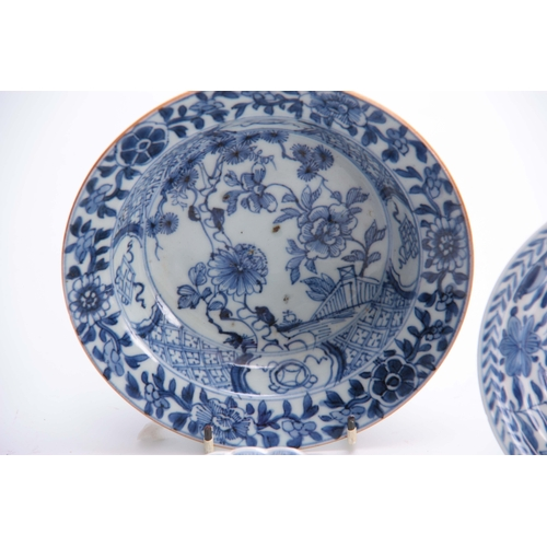 155 - AN 18TH CENTURY CHINESE SMALL SHALLOW DISH with multi floral and geometric floral panels 16cm diamet...