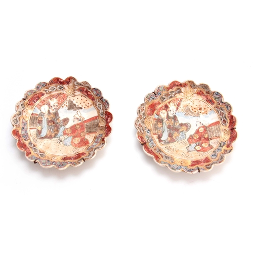 170 - A PAIR OF 20TH CENTURY JAPANESE SATSUMA SIDE PLATES with scalloped edges, decorated with figures 17c...