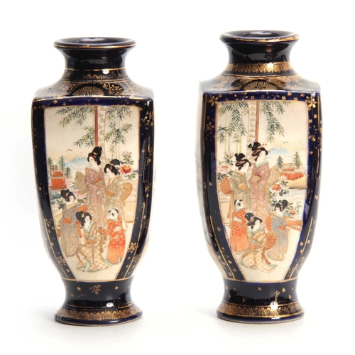 172 - A PAIR OF LATE 19TH EARLY 20TH CENTURY GILT AND ROYAL BLUE GROUND FOOTED VASES decorated with landsc...