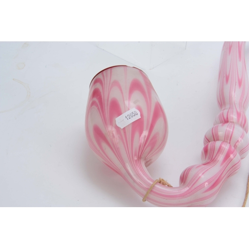 18 - A LARGE 19TH CENTURY STOURBRIDGE GLASS PIPE of twisted pink and opaque design 50cm overall....