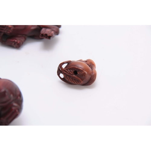 180 - A COLLECTION OF FOUR EARLY 20th CENTURY NETSUKE sculptured as various animals all with character mar...