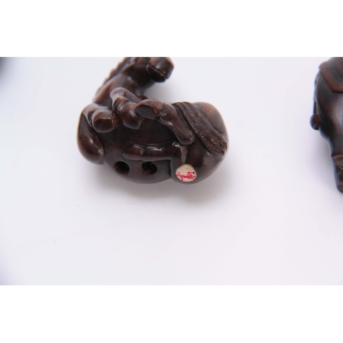 181 - A COLLECTION OF FOUR EARLY 20th CENTURY NETSUKE sculptured as various animals three with character m...